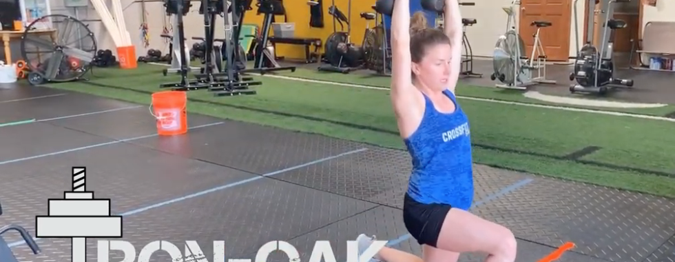 Double Kettlebell Lunge w/OH Hold